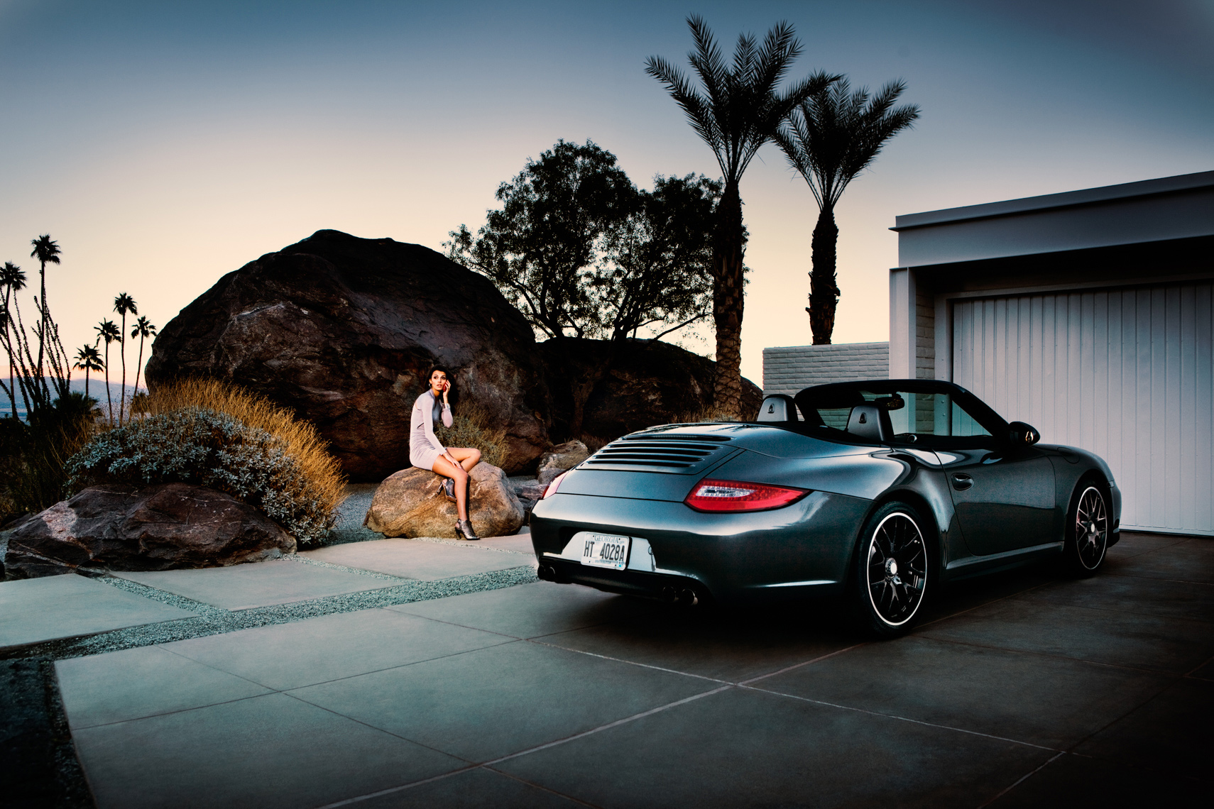 Fashion model Porsche Carrera convertible by commercial automotive car photographer fashion brandMichael Grecco