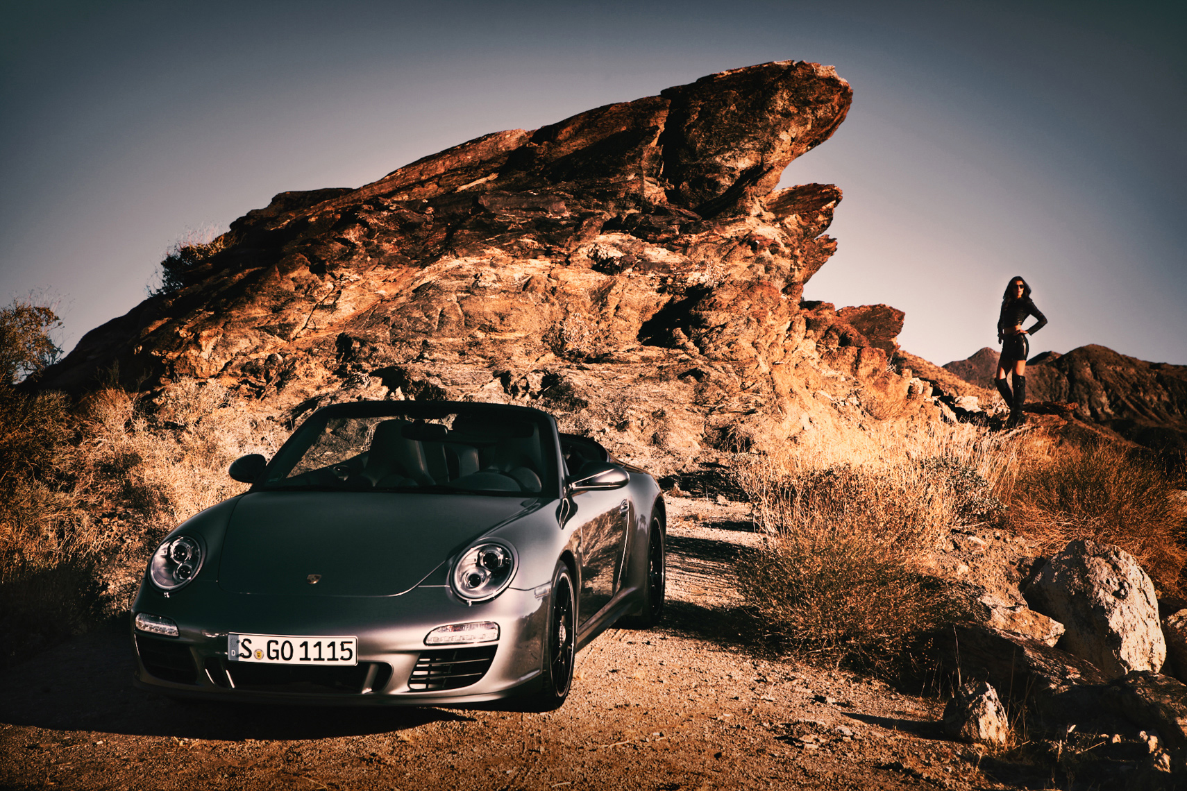 Fashion model with Porsche Carrera coupe by commercial aytomotive car photographer Michael Grecco