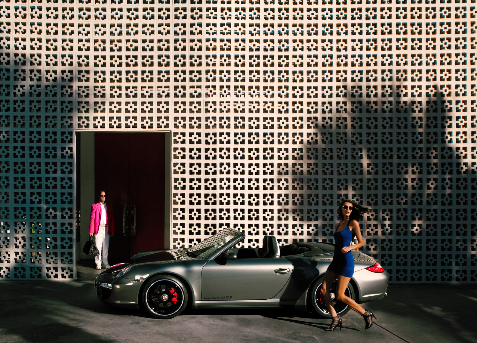Fashion model Porsche 911 convertible by commercial automotive car photographer Michael Grecco