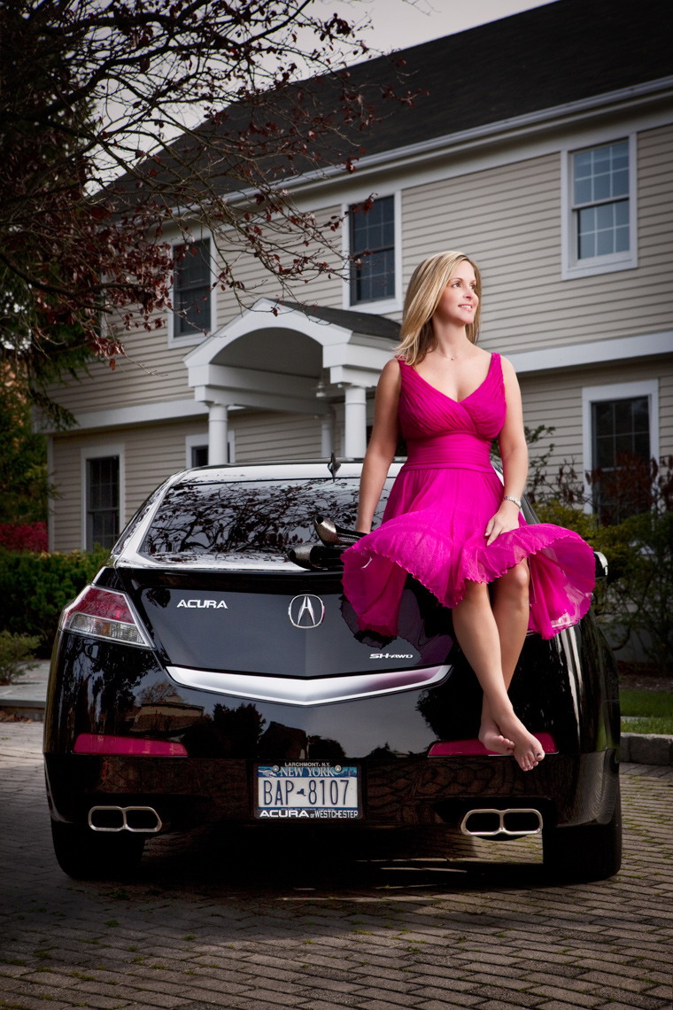 Woman sitting on a car